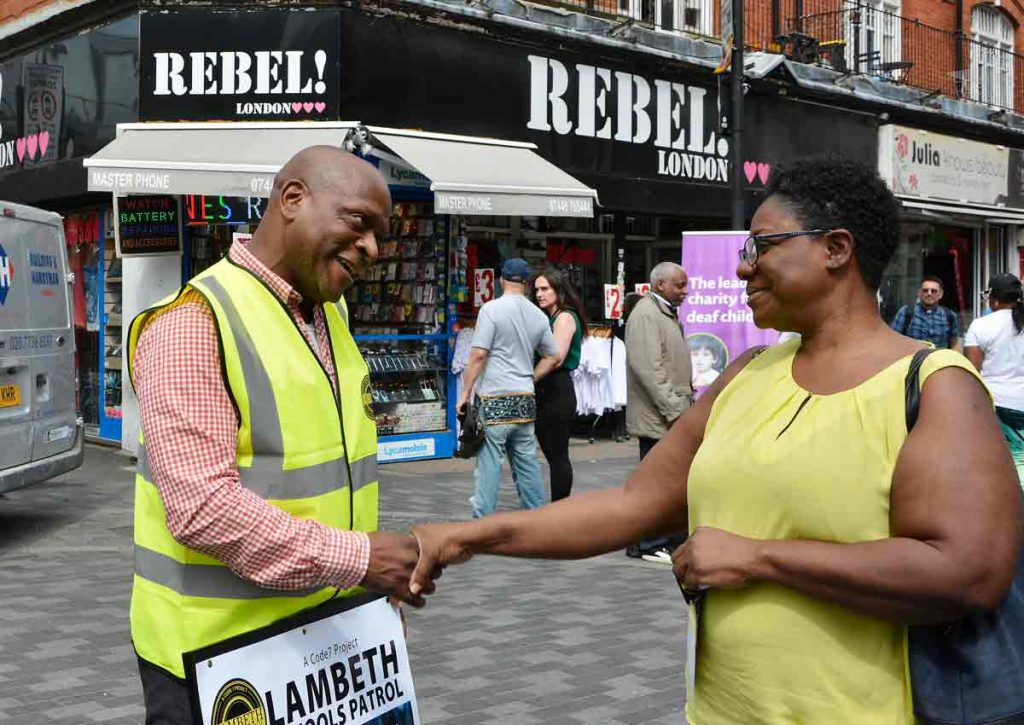 A passer-by stops to thank campaigners