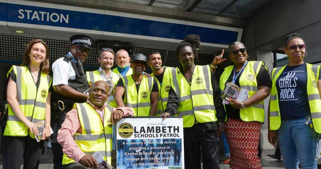 Scheme organisers and Lambeth council leader Jack Hopkins pose for pictures outside Brixton Tube