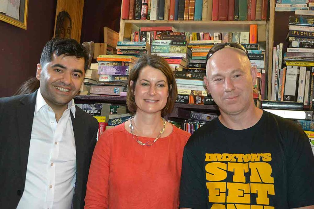 Ibrahim Dogus and Helen Hayes with Boyd Hill in the new premises