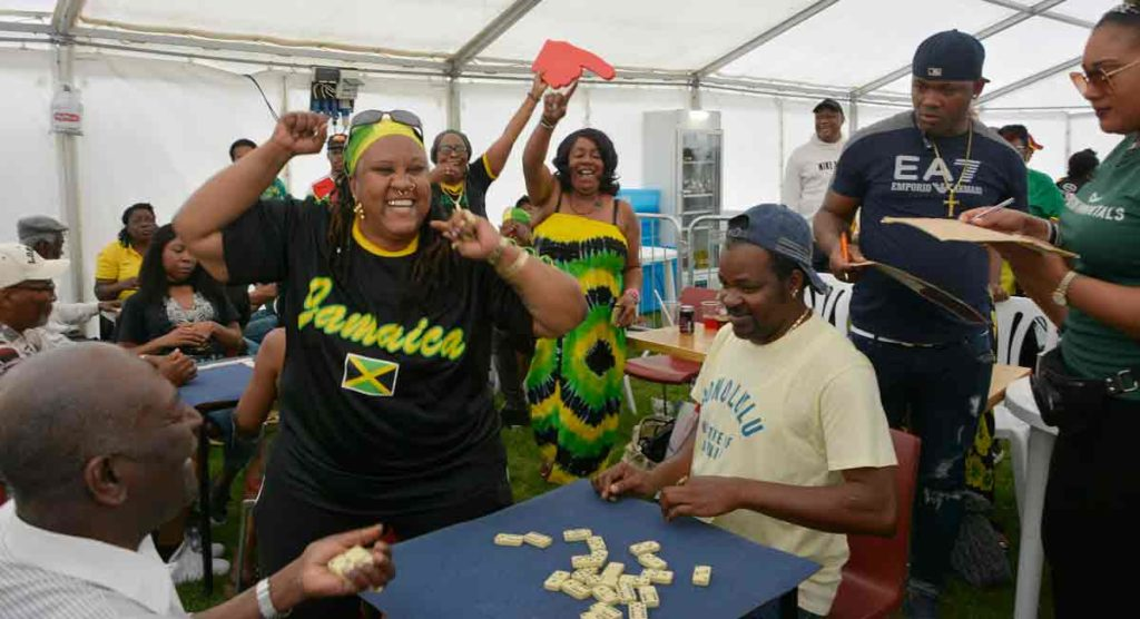 woman celebrates winning domino game