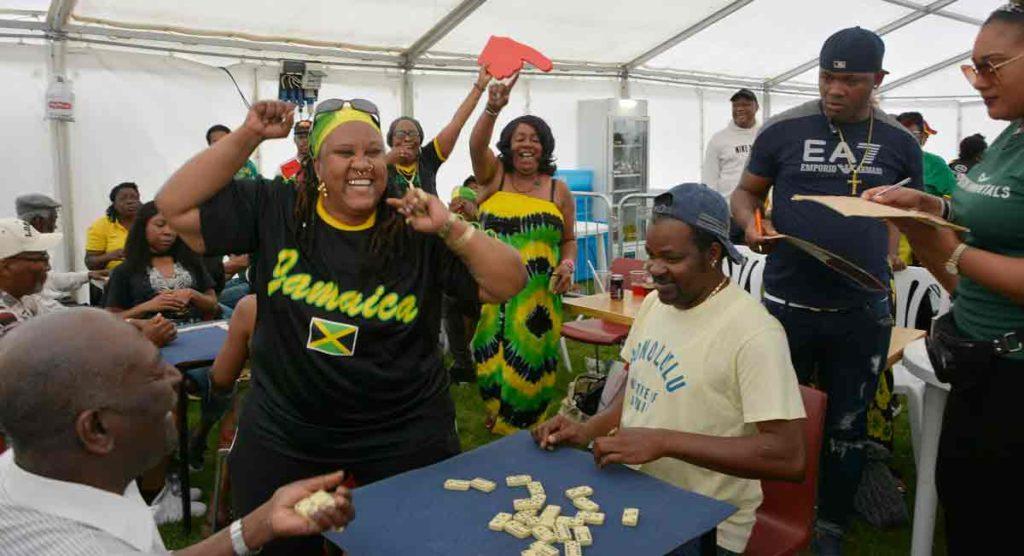 woman celebrates winning domino game