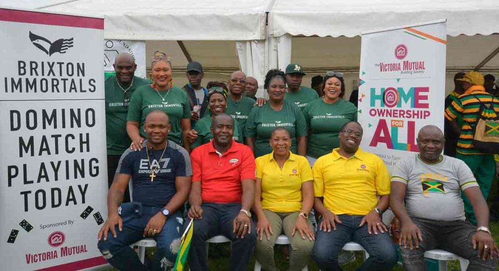 Domino club committee members with (below) representatives of sponsors Grace Foods and Victoria Mutual