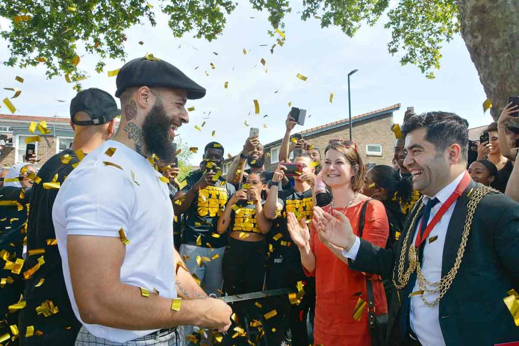 MP Helen Hayes and Lambeth n=mayor Ibrahim Dogus applaud as TerrollLewis cuts the ribbon