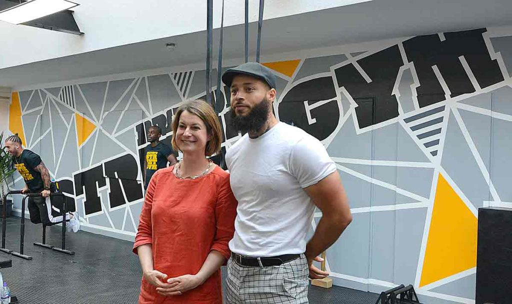 Helen Hayes and Terrell Lewis pose for pictures in the new gym