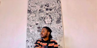 Artist Djofray Makumbu artist with one of his paintings exhibiting in Brixton Library 10 October
