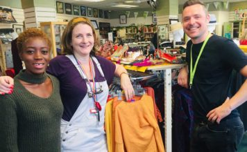 Volunteers with store manager at Barnardos