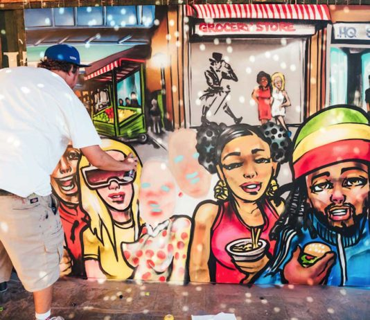 Tizer puts finishing touches to latest mural at Pop Brixton