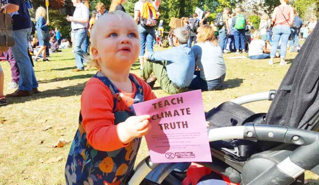 Baby with climate change flyer