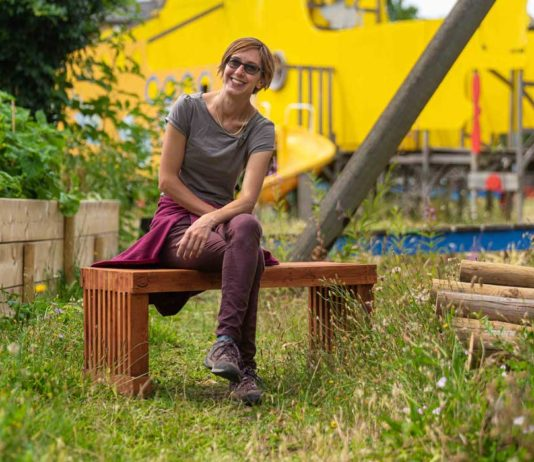 Orsetta Hosquet, project manager for the Slade Gardens scheme, tries out one of the benches made from re-cycled palettes