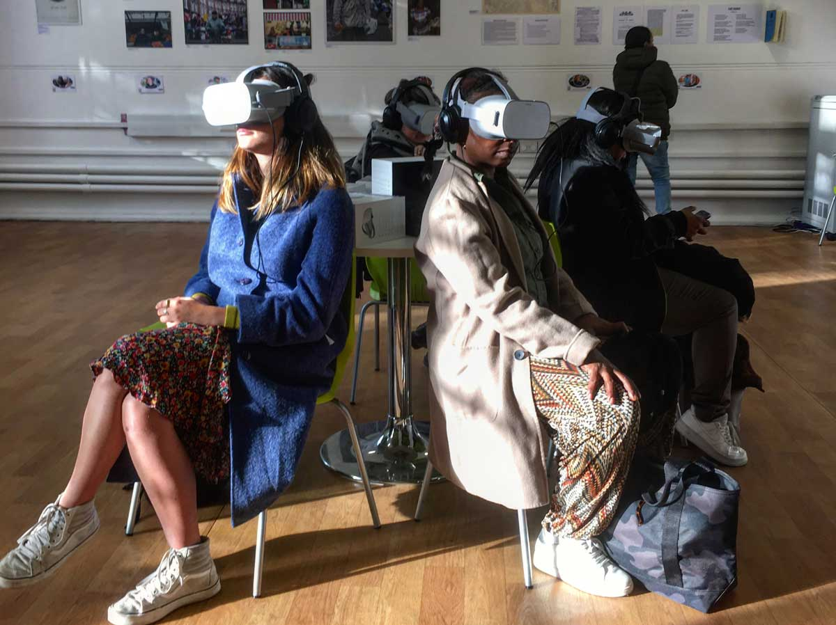 Audiences view the VR documentary while visitors explore the oral history exhibition
