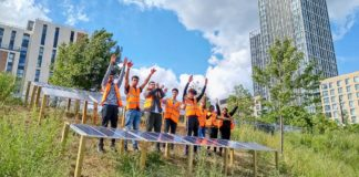 Young people with solar panels