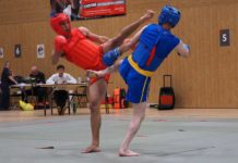 Chinese kick boxer Joshua Villar (left) in action