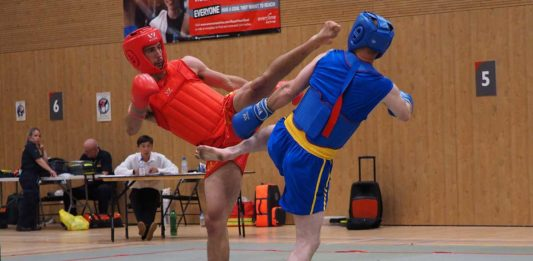 Chinese kick boxer Joshua Villar (left) in action