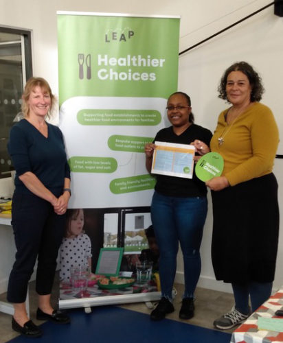 Photo 2: Left to right: Liza Ctori (Senior Community and Environmental Health Officer, LEAP); Terri-Ann Scott (Home 'N' Away); and Laura Macfarlane (Director, LEAP);  with the first LEAP Healthier Choices Award
