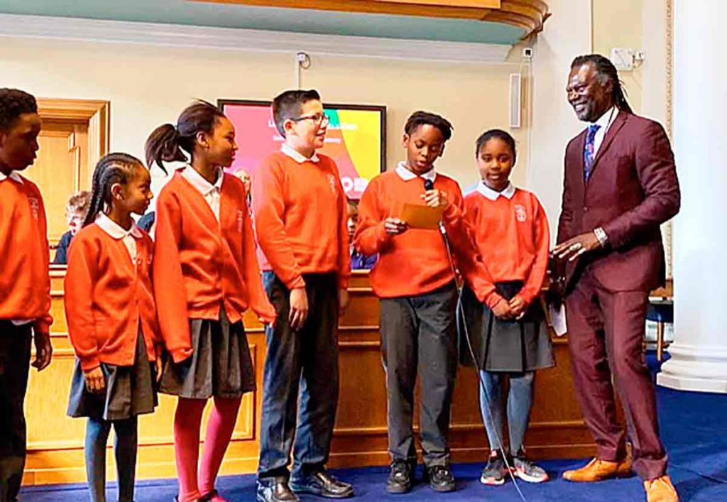 Levi Roots with St Helen's primary pupils at Lambeth town hall celebrating their Dragon's Den success