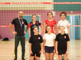 Volley ball players with coach