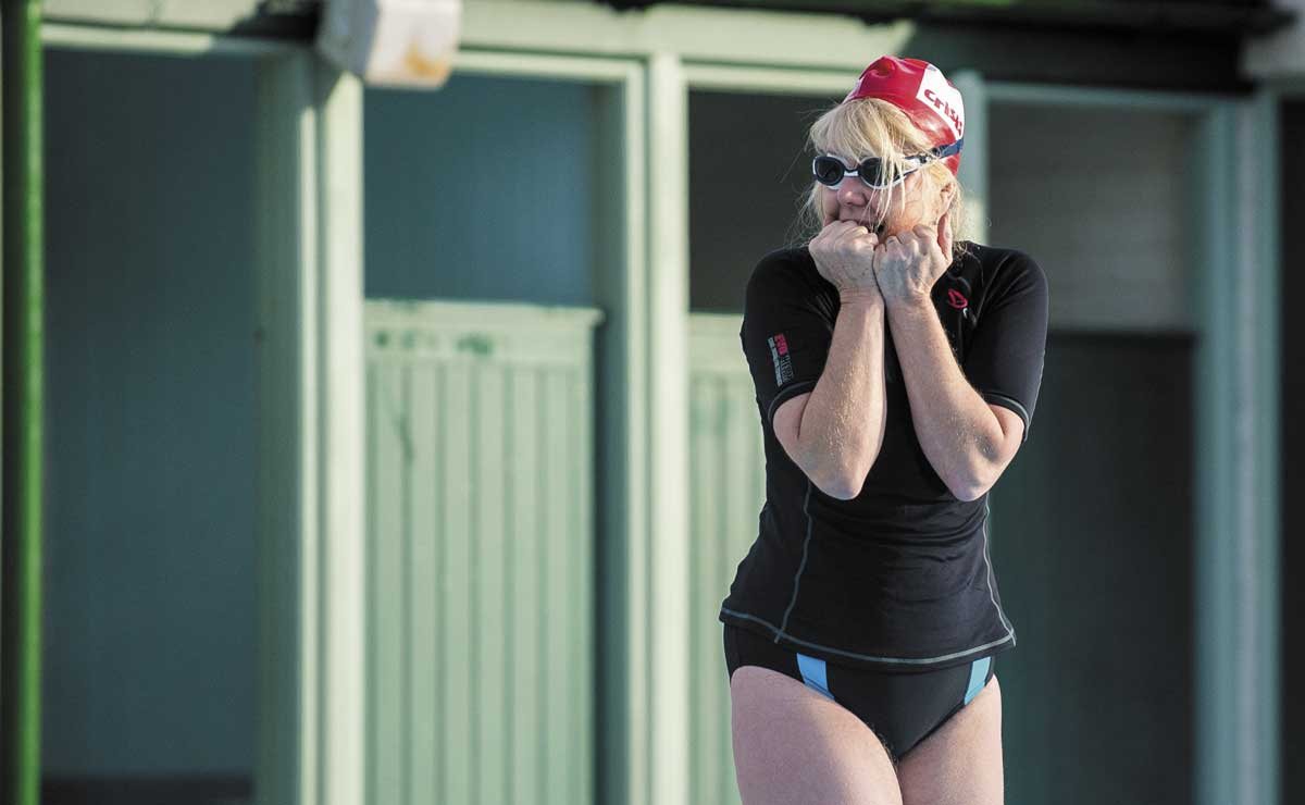 Crisis swimming challenge pic of solo swimmer looking like she's getting cold feet