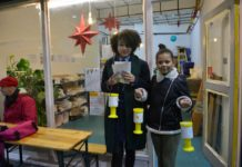 Compliments of the House volunteers Radia and Tamsyn prepare to set off from the charity's Market Row headquarters to collect outside the Tube