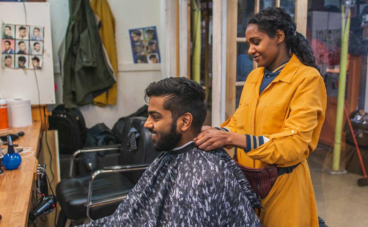 A customer getting a Saturday morning hair cut in Reliance Arcade