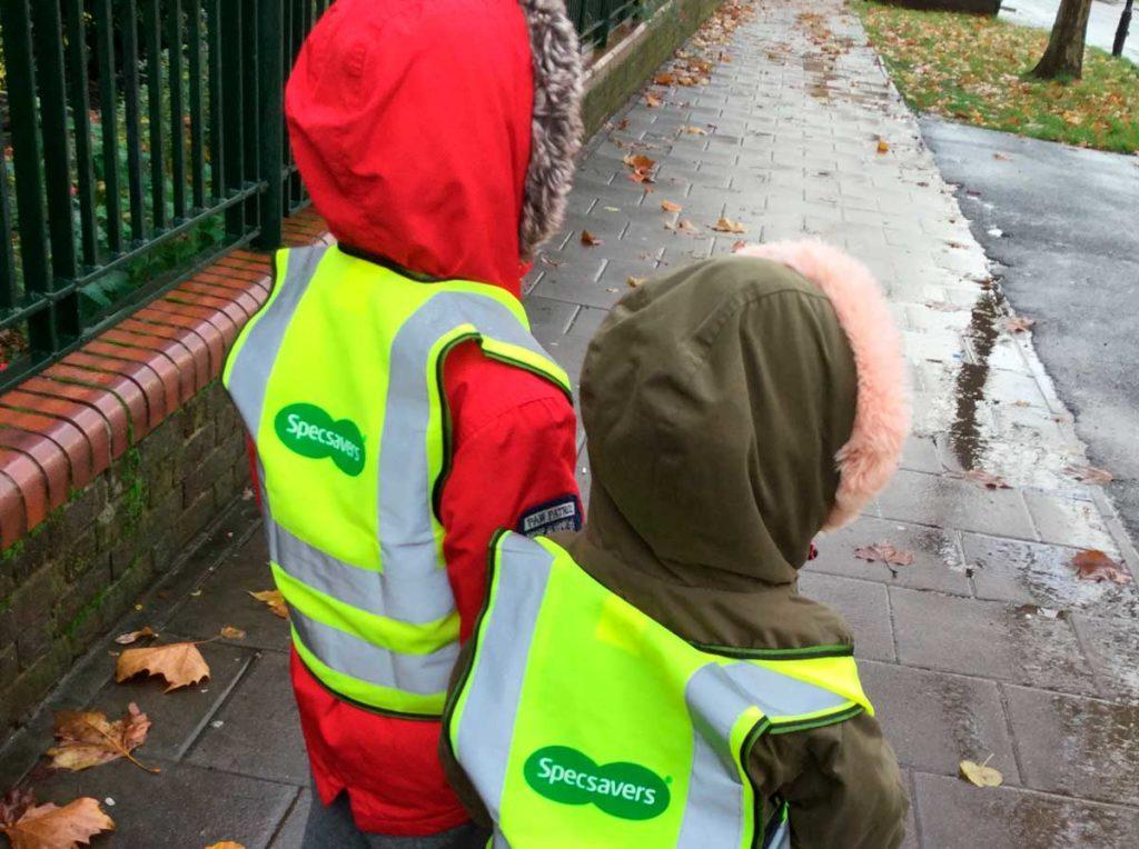 Children with hi viz vests