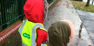 Children with hi viz vests