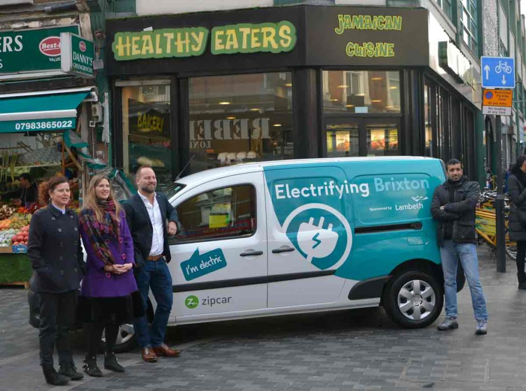 The van outside Healthy Eaters on Electric Avenue with (l-r) Cllr Claire Holland, Lambeth council deputy leader, environment and clean air; Kate Fenton, project director for Cross River Partnership; James Taylor, Zipcar UK general manager; Cllr Irfan Mohammed