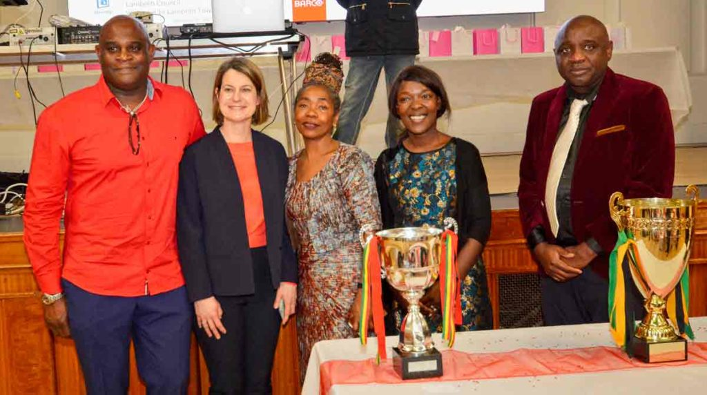 Committee member Clifton Oddman, MP Helen Hayes, Cllr Sonia Winifred, Cllr Maria Kay, and Brixton Domino Club chair Mervin Stewart