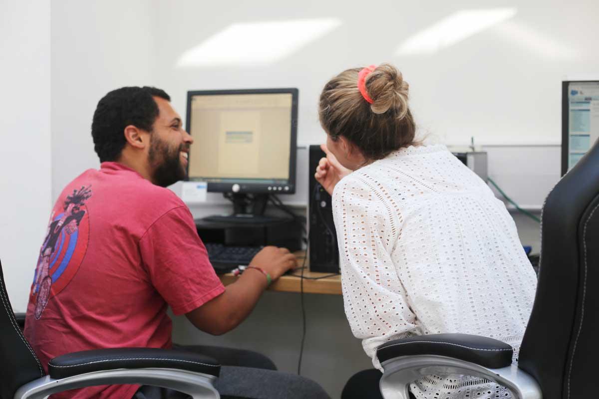 Mosaic members at a computer