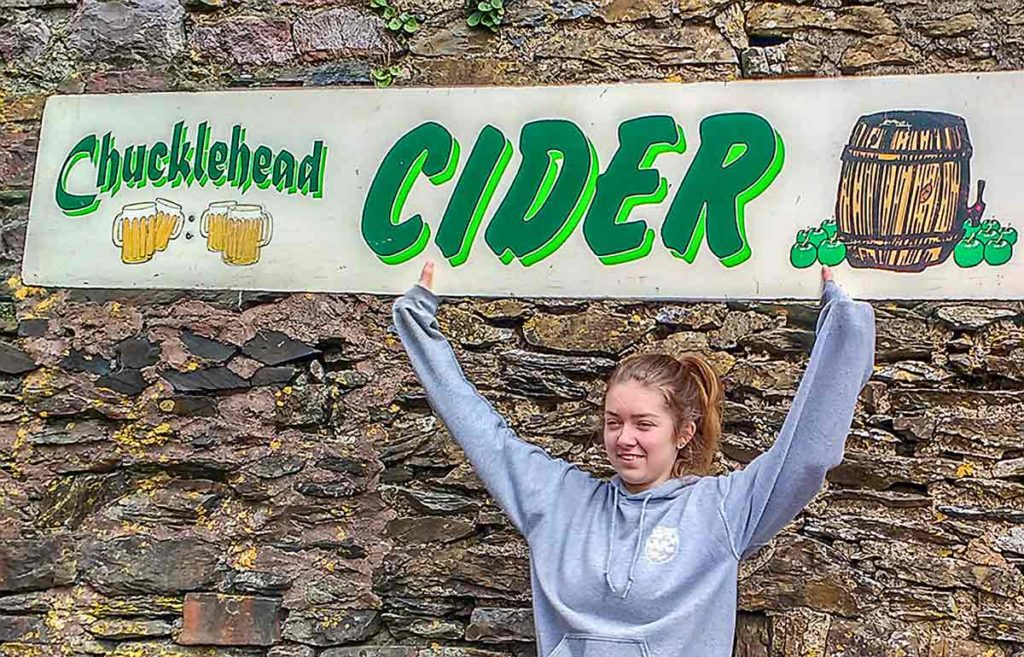 woman with Chucklehead sign