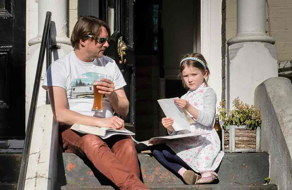 man and daughter on doorstep