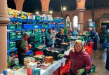 Norwood and Brixton Foodbank depot: volunteers packing
