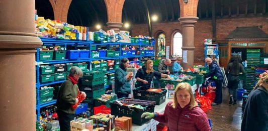 Norwood and Brixton Foodbank depot: volunteers packing