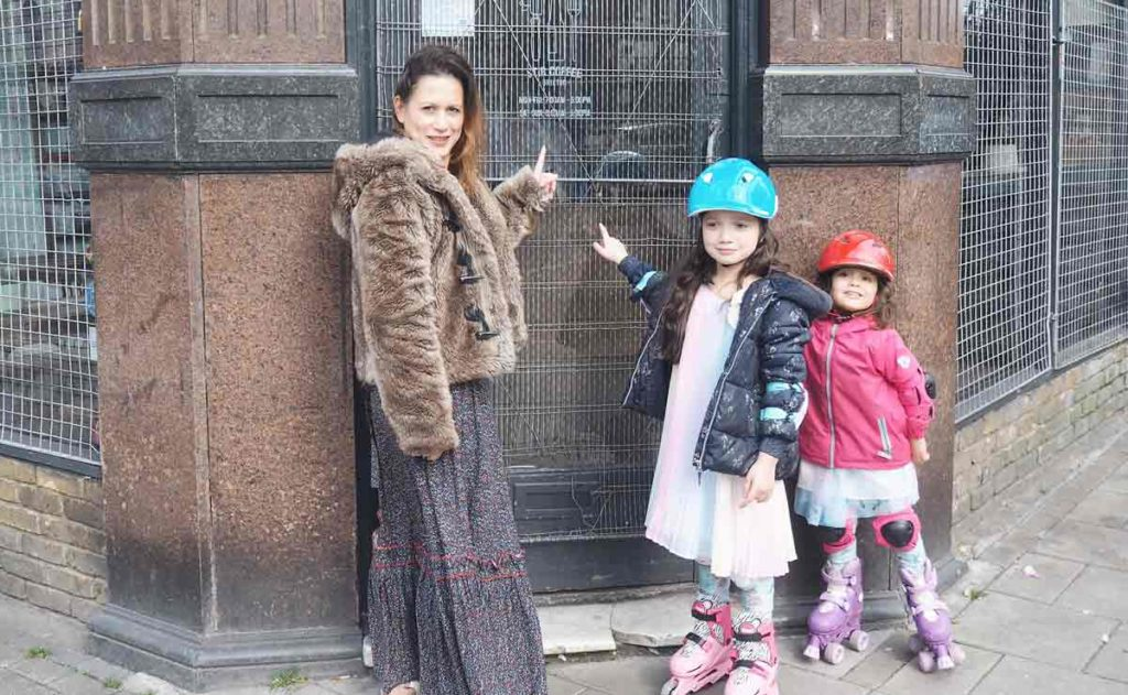 Johanna and her daughters outside Stir Coffee on Brixton Hill which is currently shut