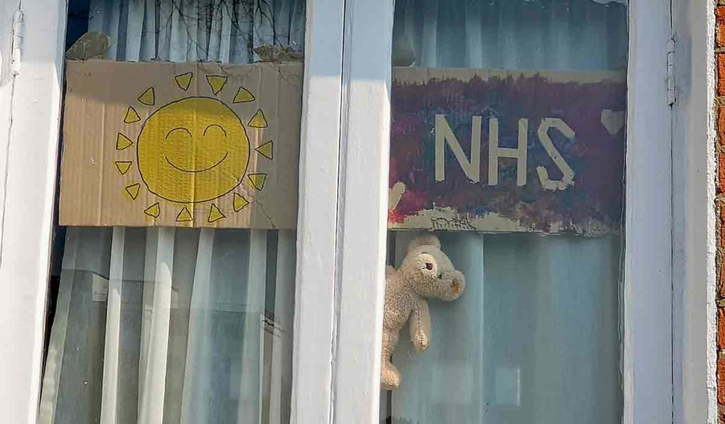 window signs and toy bear