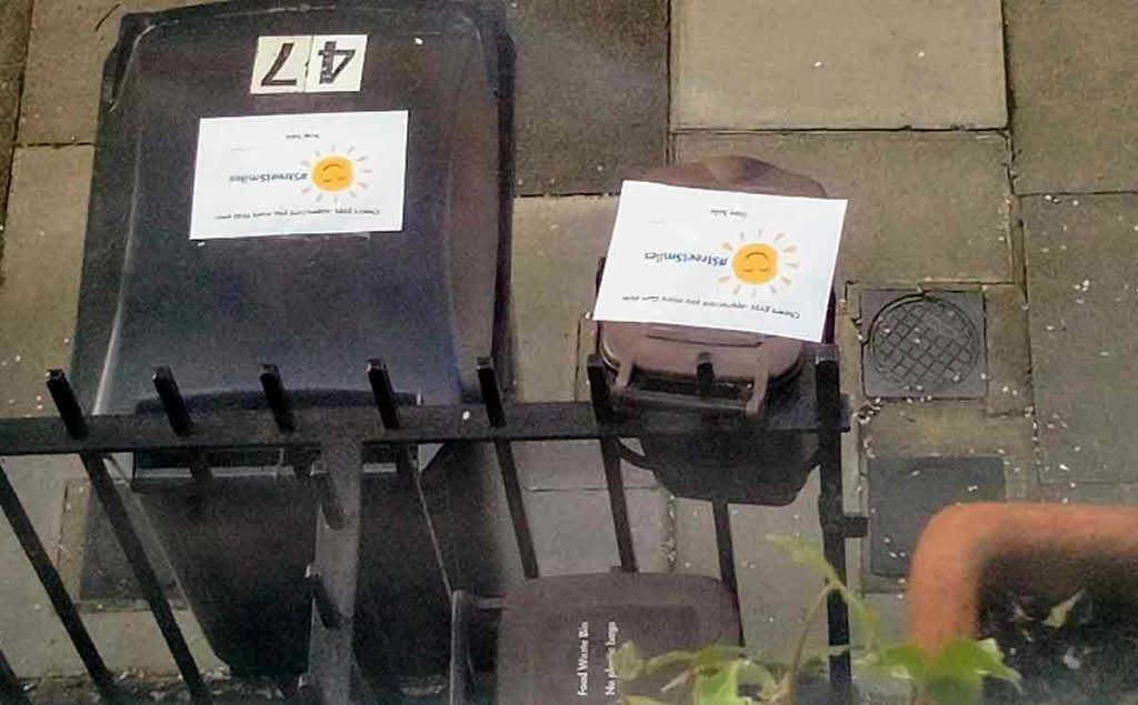 bins with posters