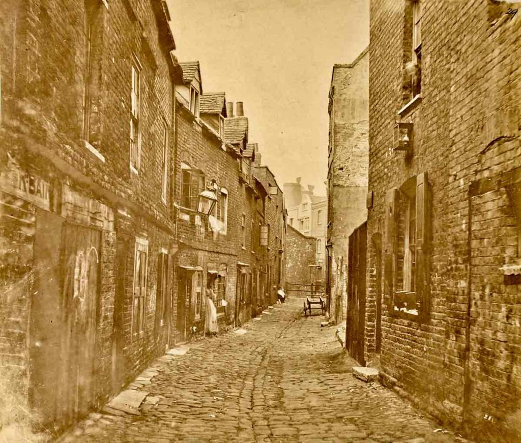 Fore Street, Lambeth, date unknwon, by an unknown photographer. A large kiln of the Doulton pottery can be sen in the background<br /> © Victoria and Albert Museum, London