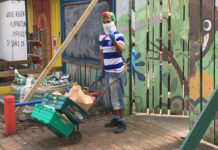 Grove Adventure playground volunteer with food boxes