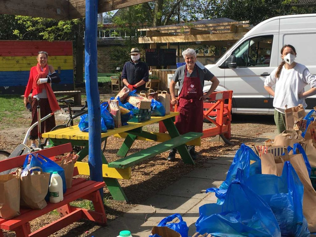 Volunteers from Grove Adventure Playground distributing food boxes to those who need it in the community