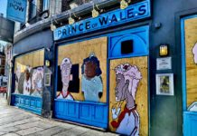 Murals on boarded-up Princeof Wales pub in Brixton