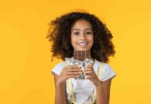 child with chocolate bar