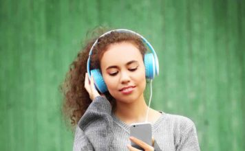woman listening on headphones