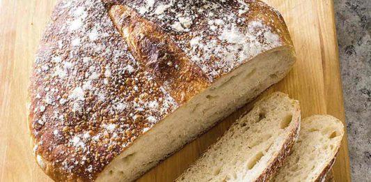 sourdough loaf sliced on board