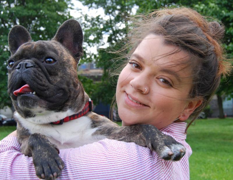 Jodie with dog looking over her shoulder