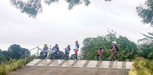 BMX riders at top of ramp