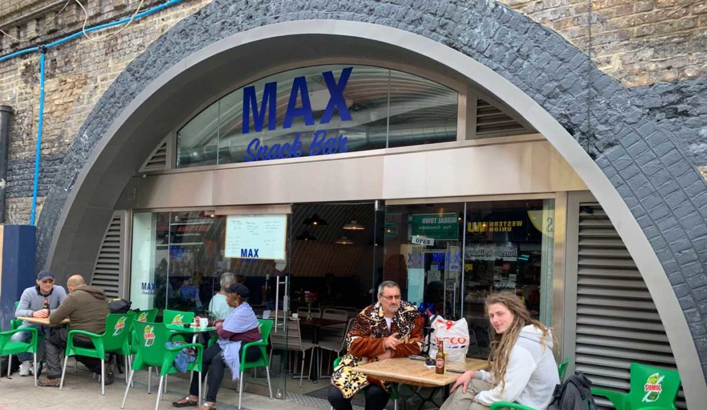 Cafe Max exterior with customers at tables