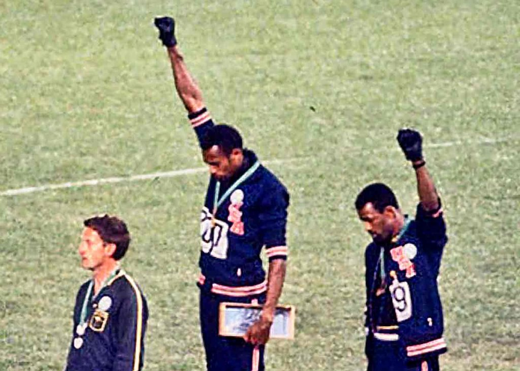 John Carlos, Tommie Smith, and the Australian Peter Norman on the Olympic podium in 1968