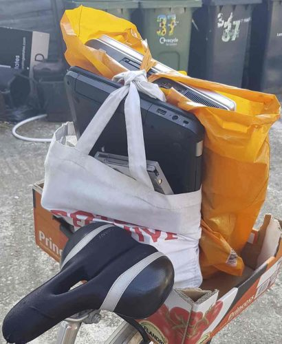 laptops in carrier bike on bicycle pannier