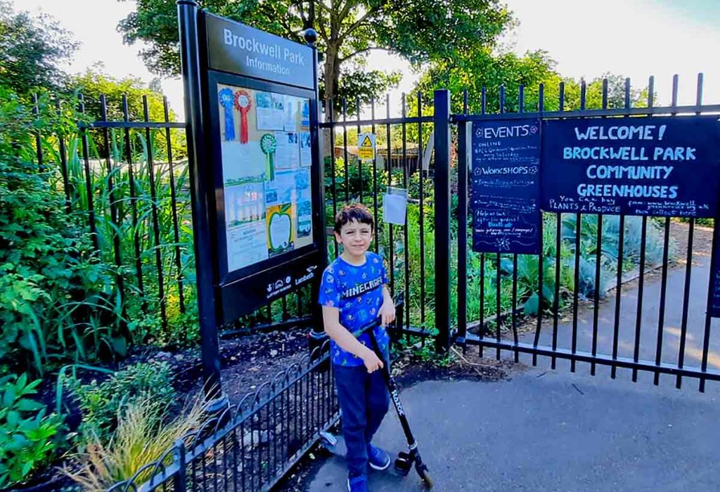 boy with scooter outside BPCG