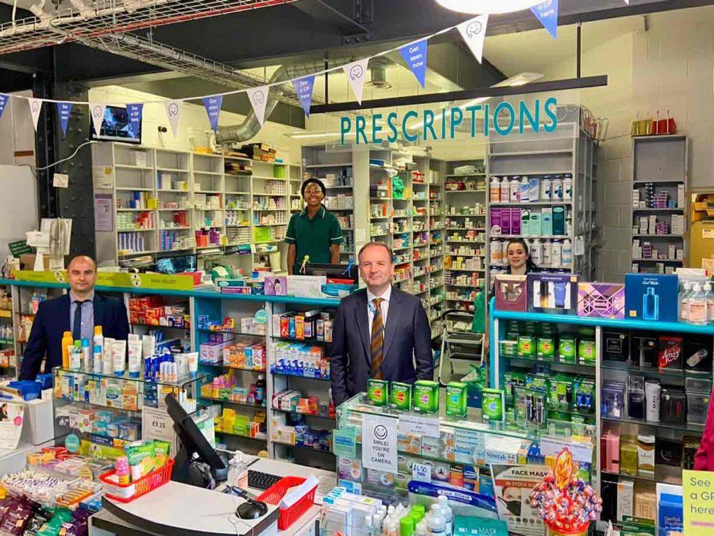 NHS chief Sir Simon Stevens in Brixton's Pavilion pharmacy
