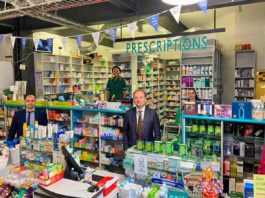NHS chief Sir Simon Stevens in Brixton's Pavilion pharmacy